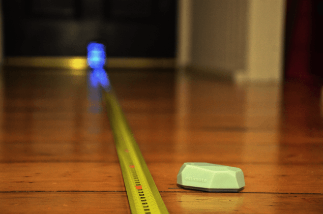 Picture estimote, tape measure and phone in experimental setting.