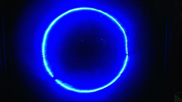 Photo of a circular LED light strip out front of a Cairns backpackers.