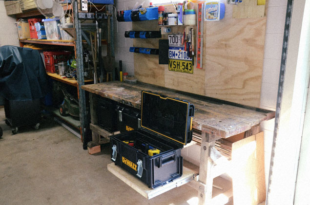 Workbench with draw slid open and toolbox open.