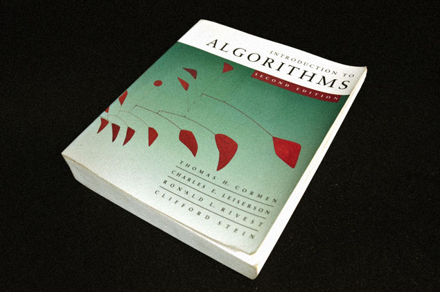 Photo the cover of the text book introduction to algorithms featuring big red by alexander calder