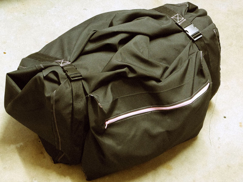 Large duffle bag for carrying an inflatable raft.