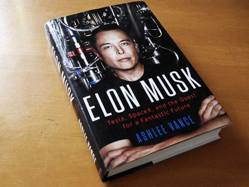 Photo of the book 'Elon Musk: Tesla, SpaceX and The Quest for a Fantastic Future' on the top of a table.