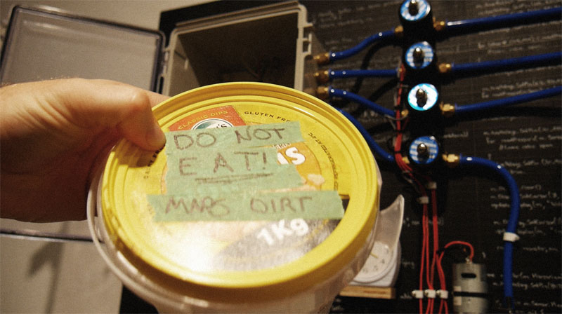 Air-tight container filled with simulant mars dirt. Labelled do not eat, mars dirt.