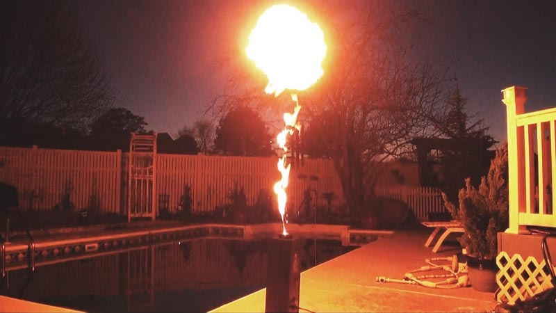 A photo of a DMX controlled flame thrower puffing fire.