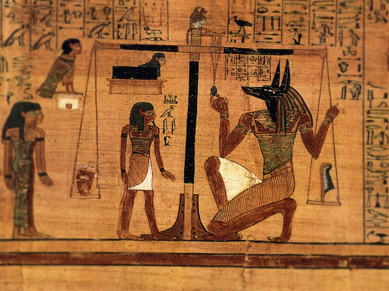 Weighing of the heart, taken from the book of the dead. Anubis weighing a heart against Maat's feather of truth.