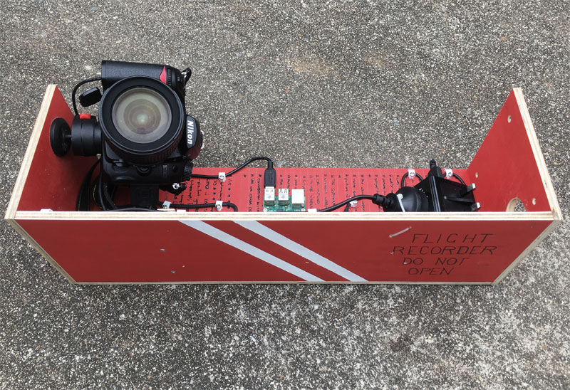 Photo of a raspberry pi time-lapse rig that has been made to resemble a flight recorder.