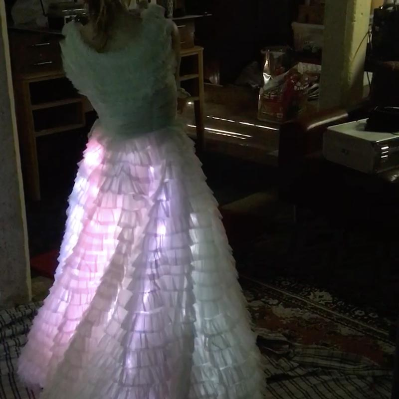A picture of a dress filled with clouds of light.