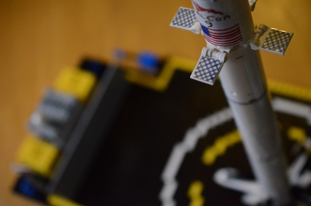 Close up of landed lego falcon 9 on autonomous spaceport drone ship.